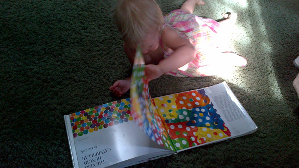 PlayBook photo of Elly reading a book.